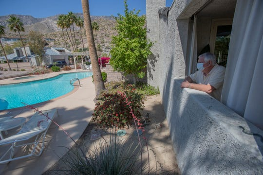 Kevin McKelvie looks at one of the swimming pools at the Vista Canyon complex in Palm Springs. Tuesday, April 21, 2020. As temperatures rise for the season, community pools are off limits because Riverside County health officials are encouraging social distancing during the coronavirus pandemic. McKelvie would like exceptions to be made for pools that don't attract a lot of people.