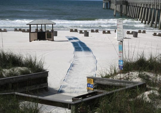 The beach near the M.B. Miller County Pier stood closed to recreational beach goers in the morning on April 20, 2020, in Panama City Beach.