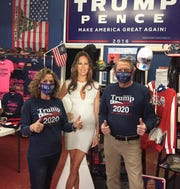 Karen MacKean and Steve Slaton, co-owners of the Trumped Store in Show Low, show off their Trump-branded facemasks in an image posted on the store's Facebook page on April 11, 2020.