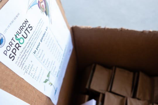 A box of packaged garden kits sits outside the front doors of the Municipal Office Center Tuesday, April 21, 2020, in Port Huron. The City of Port Huron has teamed up with MiGardener to make garden kits available for Port Huron residents during the coronavirus pandemic.