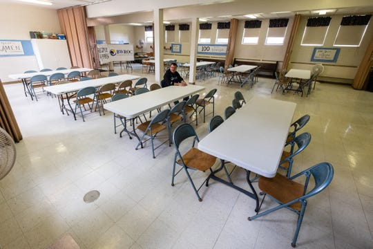 Patrick Patterson,  manager at Blue Water Recovery and Outreach Center, sits alone in an empty meeting room Tuesday, April 21, 2020, at Faith Lutheran Church in Port Huron. All of BWROC's in-person meetings and support groups have been canceled in response to the coronavirus pandemic.