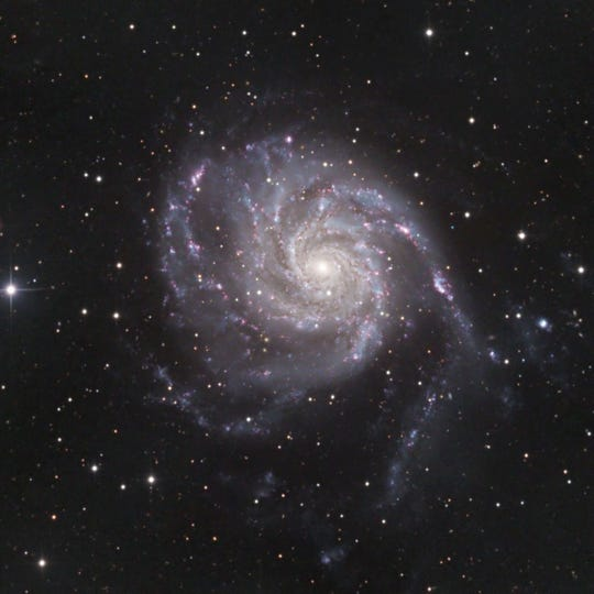 A 30 second image and a long term, refined version of the M101 spiral galaxy.
