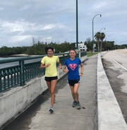Nicole Marvin (blue shirt) and her sister Sarah (yellow shirt) of Pawling are adapting to new surroundings and new challenges in running during the pandemic.
