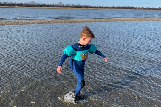 This March 18, 2020, photo released by Alexandra Nicholson shows her son, Henry Martinsen, playing at a beach in Quincy, Mass. The frustration of parents is mounting as more families across the U.S. enter their second or even third week of total distance learning, and some say it will be their last. (Alexandra Nicholson via AP)
