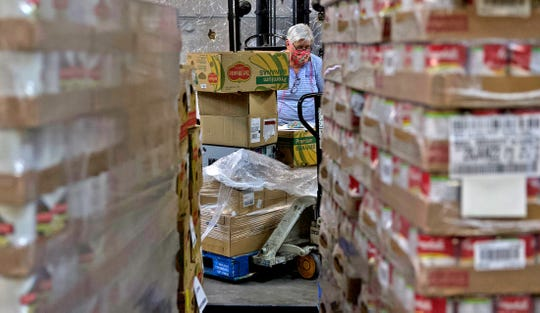 Marian Shaffer works in the distribution warehouse at the Concho Valley Regional Food Bank in San Angelo on Monday, April 20, 2020.