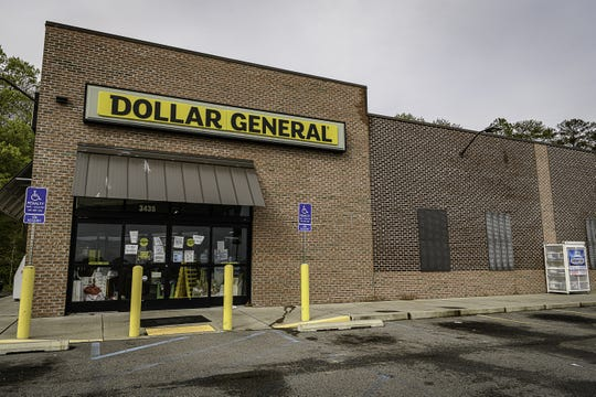 Dollar General in Exmore has new signs stating that customers won't be allowed in to shop if they are not wearing a mask.