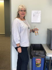 Rita McGee-Bramley recycles at work. Then she brings the items home and places them in her personal recycling bin.
