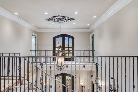 Detailed ceiling treatments create the perfect space for exquisite chandeliers.