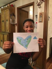 Kerrington, a Girl Scout from Troop 1303, expresses her love for the planet with cute pictures.