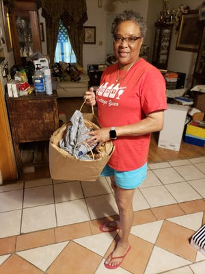 Orlisa Nash stores plastic bags and returns them to the store for recycling .