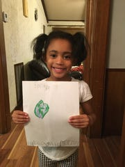 Kaleigh, a Girl Scout from Troop 1303, expresses her love for the planet with cute pictures.