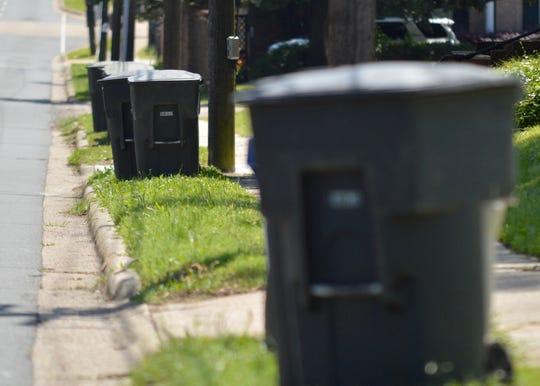 Garbage bins line a curb near Shreveport's South Highland neighborhood on Tuesday, April 21, 2020.