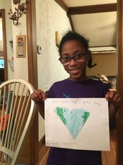 Kamryn, a Girl Scout from Troop 1303, expresses her love for the planet with cute pictures.