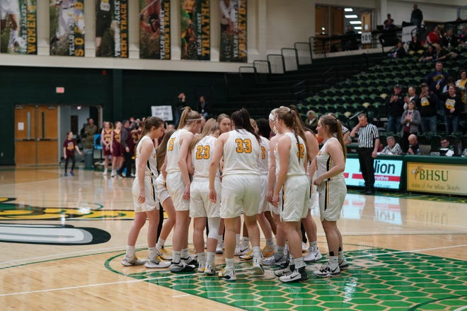 The Faulkton Area girls basketball  team huddles before their Class B quarterfinal game against De Smet.