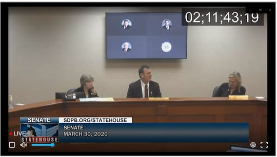 Senators investigating an allegation that Senate Majority Leader Kris Langer was intoxicated at the Capitol on March 30 viewed video footage of Lt. Gov. Larry Rhoden, center, and Langer, right, during the Senate's recess.