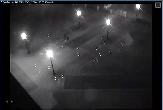 Security camera footage shows Sen. Kris Langer and Sen. Brock Greenfield entering the South Dakota Capitol at 1:23 a.m. March 31.
