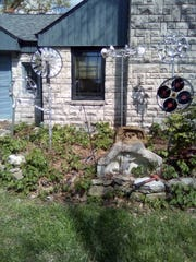 This is David Baker's 'Bicycle Wheel Whirly Gigs' art instillation. Baker is participating in Lawn Art With Neighbors.