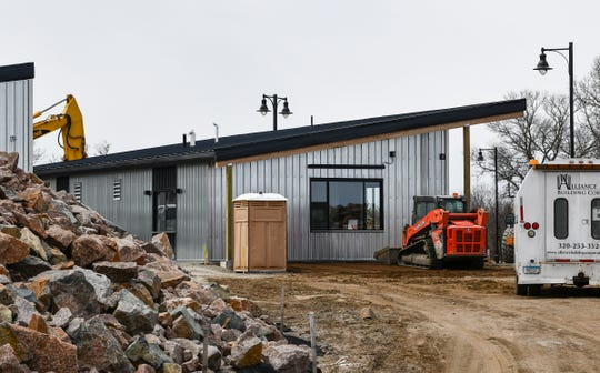 Work is underway on the ticket and concession buildings at The Ledge amphitheater Tuesday, April 21, 2020, in Waite Park.