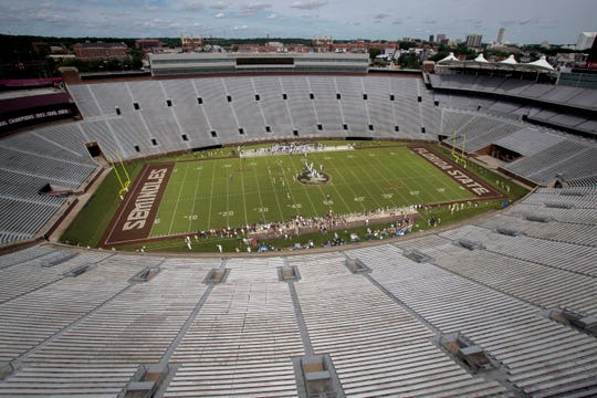 In a photo illustration composed of two images, the stadium seats of Doak Campbell Stadium are empty during a Florida State football game. There is a possibility that this is what the football season could look like.