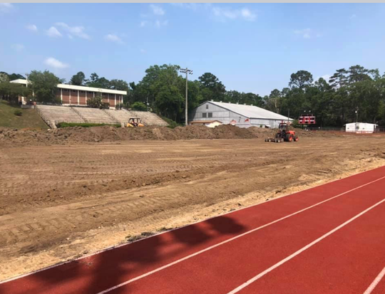Contractors dug up the grass in preparation for the turf installation at Leon High School.