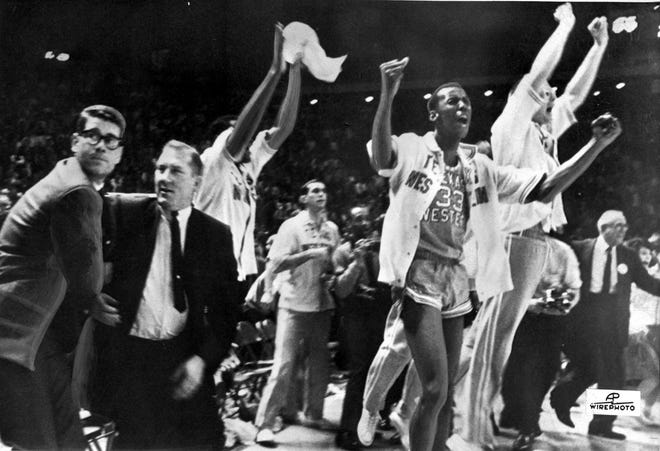 Texas Western basketball coach Don Haskins, second from left, and players celebrate after winning the NCAA basketball championship on March 19, 1966 in College Park, Md. Texas Western started five African-Americans ? Willie Worsley, Orsten Artis, Bobby Joe Hill, David Big Daddy Lattin and Harry Flournoy  against Kentucky in the NCAA championship game.