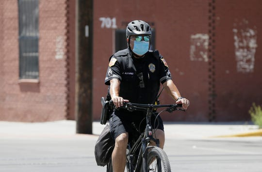 Officer Alvarez of the El Paso Police Department takes precautions against coronavirus as he patrols downtown Tuesday, April, 21, 2020.