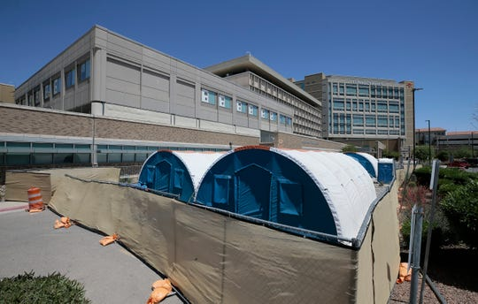 Tents where coronavirus patients are being treated fill the front of University Medical Center of El Paso.