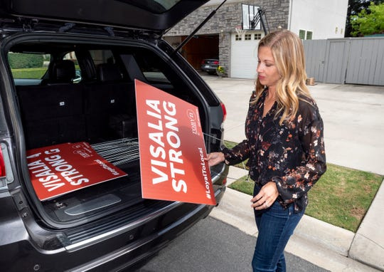 """Realtor Robyn Icenhower places a yard sign on Monday, April 20, 2020. She is distributing the signs throughout Tulare County with messages of hope like""""VISALIA STRONG,"""" """"BETTER TOGETHER"""" and """"HOPE."""""""