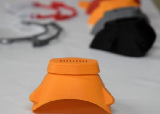 Completed 3-D printed face mask and face shield components are laid out on a table at Wittman Village Community Center on Monday, April 20, 2020. ProYouth employees have printed the masks and shields pieces around the clock to donate to health care workers and police.