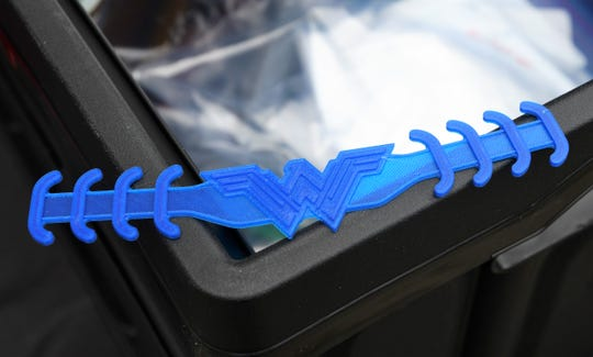 This Wonder Woman-themed ear guard will be donated to Kaweah Delta Medical Center for health care workers who have to wear protective masks for long periods of time. It was made using a 3-D printer.