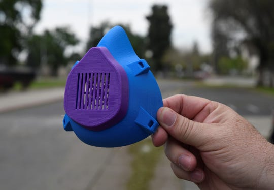 Mt. Whitney High School principal Rick Hamilton holds an assembled 3-D printed face mask on Monday, April 20, 2020. The mask will be donated to Kaweah Delta Medical Center.