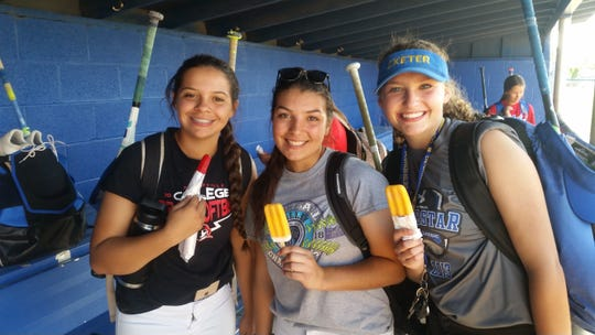 Nicole Rocha, left, Larissa Thompson, middle, and Haylee McFall are seniors on the Exeter High School softball team.