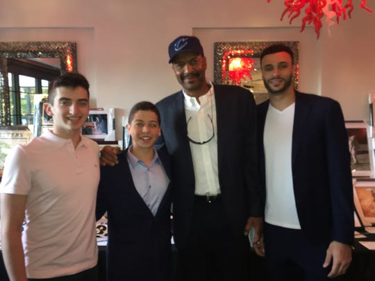 Left to right: Scarsdale residents Max Roth and Noah Weber with Larry Nance Sr (retired Cleveland Cavalier) and Larry Nance Jr (Cleveland Cavalier) at  a 2019 Athletes vs Crohn's event.