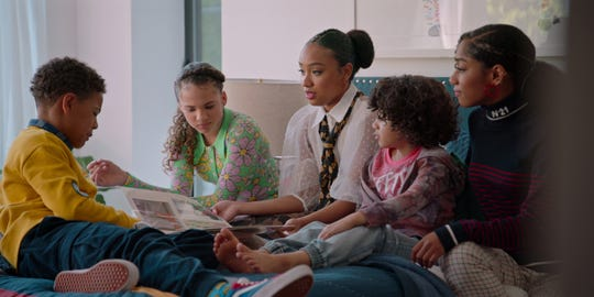 """From left to right: Justin Claiborne as Pops Barris; Scarlet Spencer as Izzy Barris; Genneya Walton as Chloe Barris; Ravi Cabot-Conyers as Kam Barris; and Iman Benson as Drea Barris in Netflix's """"#BlackAF."""""""