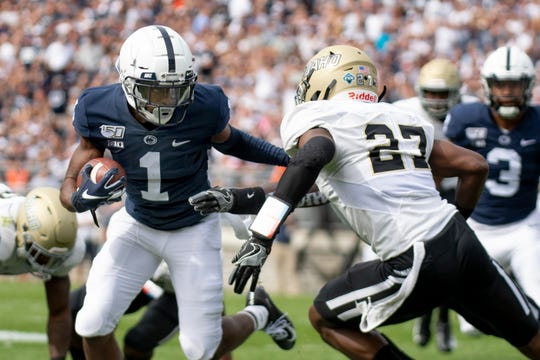 Penn State wide receiver K.J. Hamler (1) looks to elude an Idaho defender during the first quarter of an NCAA college football game in State College, Pa., on Saturday, Aug. 31, 2019. (AP Photo/Barry Reeger)