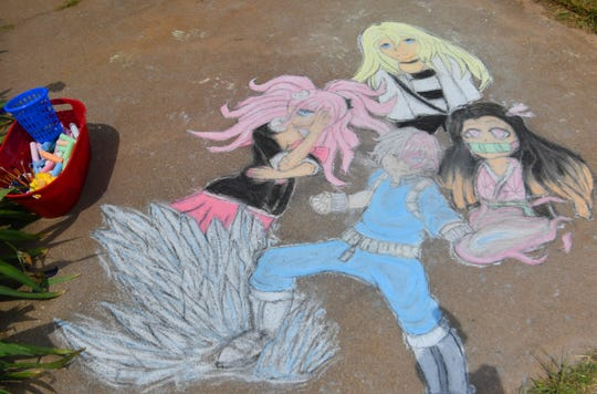 Popular anime characters were drawn in sidewalk chalk by junior high artist Meagan Perry at her Wichita Falls home.