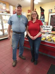 John Hamm, of Wisconsin River Meats, and Denise Wee, sales and marketing manager pause for a photo in the store.