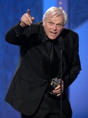 """This June 8, 2003 file photo shows actor Brian Dennehy accepting the Tony award for best actor in a play for """"Long Day's Journey into Night"""" during the 57th Annual Tony Awards in New York. Dennehy, the burly actor who started in films and later in his career won plaudits for his stage work in plays, died of natural causes on Wednesday, April 15, 2020 in New Haven, Conn. He was 81."""