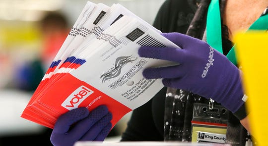 An election worker sorts vote-by-mail ballots for the presidential primary at King County Elections in Renton, Washington on March 10, 2020.