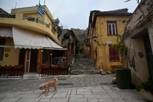 A dog walks in the deserted Plaka touristic district in Athens, on April 14, 2020, during a lockdown imposed to stem the COVID-19 pandemic, caused by the novel coronavirus.