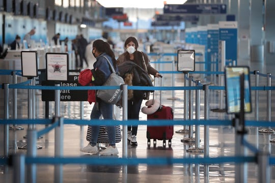 Passenger go through TSA screening at a nearly-deserted O'Hare International Airport on April 2, 2020 in Chicago, Illinois.