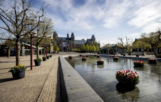 The Museumplein square located next to museums is deserted in Amsterdam, on April 16, 2020, amid the COVID-19 outbreak caused by the novel coronavirus.