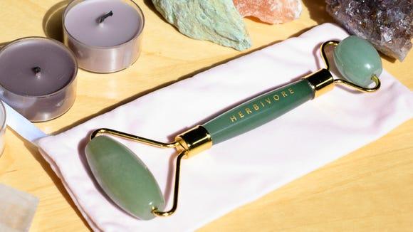 Pamper your skin with the Herbivore Jade Facial Roller.