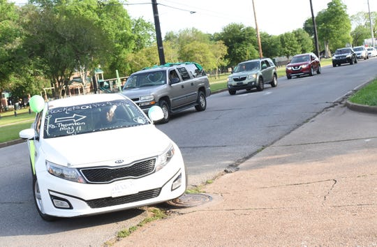 Faculty and staff from W.O. Hall Sixth Grade Academy and Arthur F. Smith Middle Magnet paraded through several neighborhoods where their students live to show them that they are are missed.