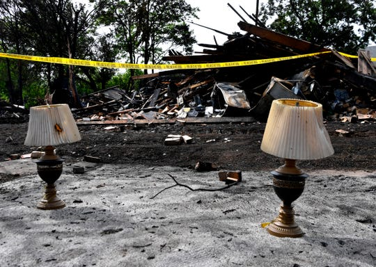 Lamps are set aside after being salvaged from an overnight fire in the 1600 block of Chestnut Street Wednesday.