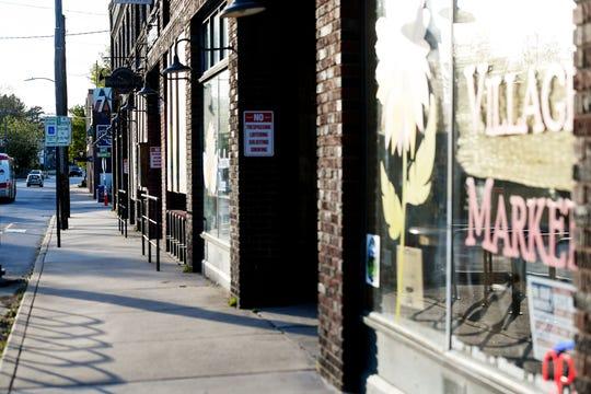 Sidewalks were empty in West Asheville amid the coronavirus April 21, 2020.