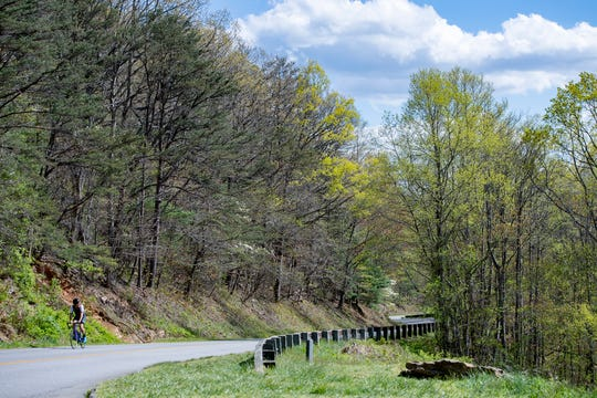 A bicyclist rides up the Blue Ridge Parkway near the Haw Creek Valley Overlook on April 21, 2020. While most of the parkway has closed due to COVID-19 certain sections around Asheville remain open.