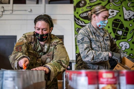 U.S. Air Force National Guard packages food at South Michigan Food Bank in Battle Creek, Mich. on Tuesday, April 21, 2020 as unemployment numbers soar to record highs throughout the COVID-19 pandemic.