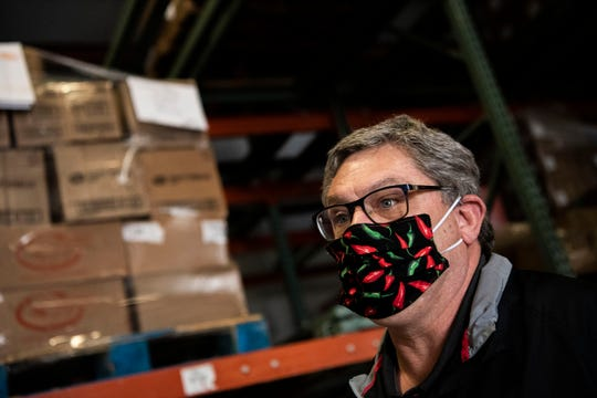 South Michigan Food Bank Chief Executive Officer Peter Vogel manages donations on Tuesday, April 21, 2020 in Battle Creek as unemployment numbers soar to record highs throughout the COVID-19 pandemic.