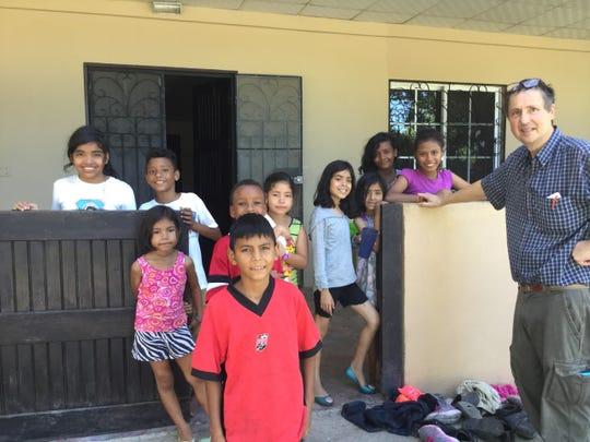 Reid Fitzsimons alongside children at the Casa Cielo orphanage in 2018.